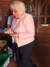 Flint Parishioners getting involved by signing the Power to Be campaign cards